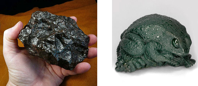 A greasy-looking black meteorite and a bloodstone toad statue of malignant aspect